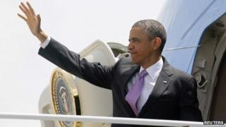 US President Barack Obama waves from Air Force One at Chicago's O'Hare Airport 30 May 2013