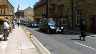 The funeral procession on Half Moon Street in Sherborne