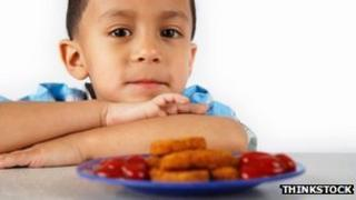 Child and fish fingers