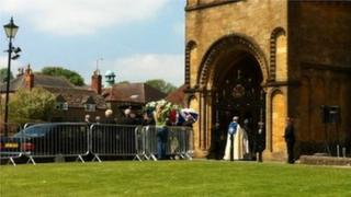 Andrew Simpson's coffin being carried into Sherborne Abbey