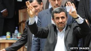 Mahmoud Ahmadinejad waves as he arrives in Accra, Ghana