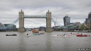 The Queen's Rowing Barge Gloriana led the vessels beneath Tower Bridge