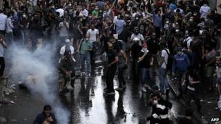 Protestors clash with Turkish riot policemen during a protest against the demolition of the Taksim Gezi Park in Istanbul