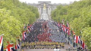 The cyclists stopped on The Mall and formed in the colours of the Help for Heroes medal