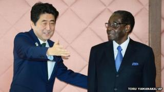 Robert Mugabe and Japanese PM Shinzo Abe (left) prior to talks in Yokohama, Japan (1 June 2013)