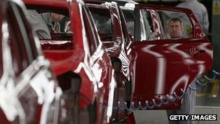 A technician assembles a Nissan car on the production line at Nissan's Sunderland plant in the UK