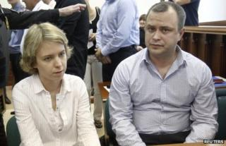 The children of Anna Politkovskaya, Vera (L) and Ilya, look on before the court hearing in Moscow, 3 June