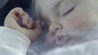 Child surrounded by smoke