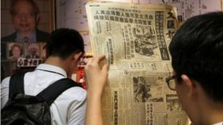 A student in Hong Kong reads a 1989 newspaper on the Tiananmen Square crackdown