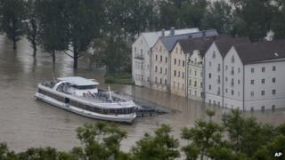 A boat waits in front of the flooded old centre of Passau