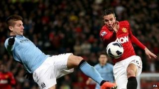 Manchester City's Matija Nastasic (left) and Manchester United's Robin van Persie