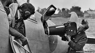 Camera being loaded into an aircraft