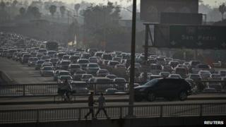 Traffic is seen backed up in all directions on Interstate 110 in downtown Los Angeles, California, 22 March 2012
