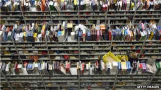 Hundreds of books in shelves at the logistic centre of Amazon in Bad Hersfeld, eastern Germany