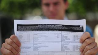 Man holding a copy of the Dartford River Crossing Survey