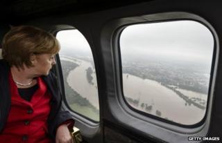 German Chancellor Angela Merkel surveys the Elbe flooding from an aircraft, 4 June