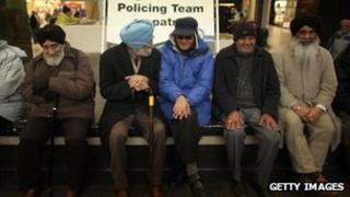Sikh men sitting in West Bromwich