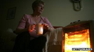 woman with electric heater