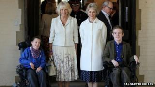 The Duchess of Cornwall and Duchess of Gloucester with Chailey Heritage School pupils Keelie Sayers and Thomas Knightingale