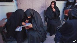 Iranian women fill up their ballots before voting for Parliamentary elections in Tehran Friday, Feb. 18, 2000