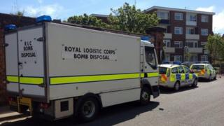 Bomb disposal van and police cars