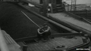 Old image of canal cargo barge