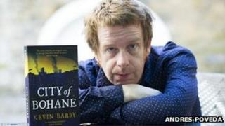 Kevin Barry with his book