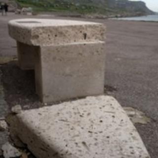 Damaged memorial bench
