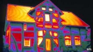 Thermal image of house showing heat loss