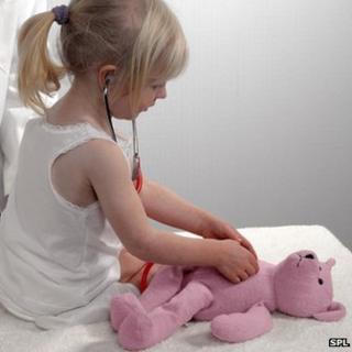 Girl examining her teddy