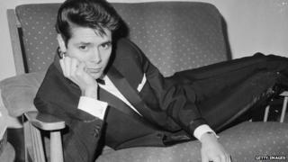Cliff Richard on a sofa, 1963