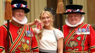 British Olympic cyclist Laura Trott with members of the Yeoman of the Guard