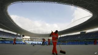 In this 2007 file photo, workers clean the Joao Havelange stadium