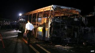 Investigators examine bus in city of Xiamen. 7 June 2013