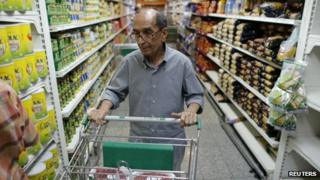 A man in a supermarket in Caracas on 16 May 2013