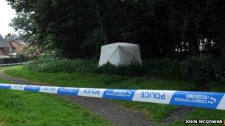 Police forensic tent at the scene