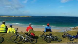 Cyclists beside beach