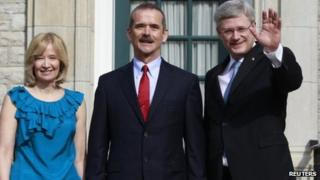 Canadian astronaut Chris Hadfield meets with Canada's Prime Minister Stephen Harper (R) and his wife Laureen at 24 Sussex Drive in Ottawa 10 June 2013