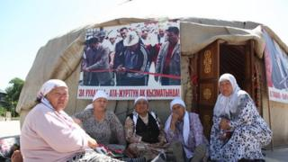 Elderly Kyrgyz women sitting near a traditional yurt in Jalalabad, Kyrgyzstan