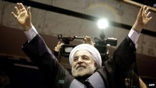 Hassan Rowhani waves to the crowds at a campaign rally in Tehran on 8 June 2013