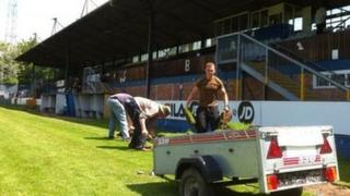 Worcester City fans taking away the pitch at St George's Lane