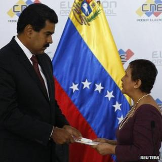 The opposition has accused Tibisay Lucena (right) of taking orders from President Nicolas Maduro (left)