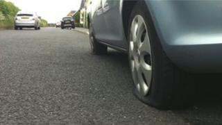 Car with its tyre slashed