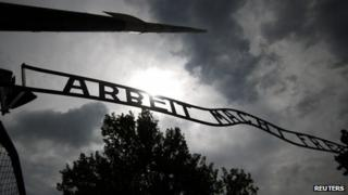 "The sign ""Arbeit macht frei"" at the main gate to the Auschwitz concentration camp is seen on June 11, 2013."