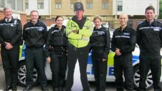 """Police officers and a """"cut-out cop"""""""