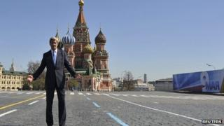 US Secretary of State John Kerry poses in front of St. Basil's cathedral during a walk at the Red Square in Moscow, May 7, 2013