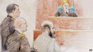In this courtroom sketch, U.S. Army Maj Nidal Hasan, right, sits during a hearing at Fort Hood, Texas, 11 June 2013