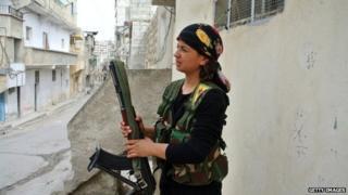 A rebel fighter holds a weapon in Aleppo