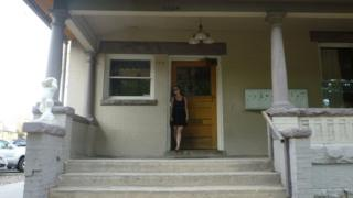 Kait McNamee outside her apartment building