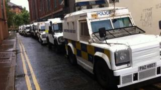Police vehicles line the route of the march in Belfast